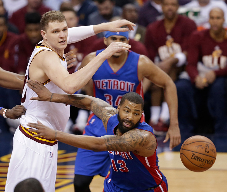 . Detroit Pistons\' Marcus Morris (13) goes after a loose ball against Cleveland Cavaliers\' Timofey Mozgov (20), from Russia, in the first half in Game 2 of a first-round NBA basketball playoff series, Wednesday, April 20, 2016, in Cleveland. (AP Photo/Tony Dejak)