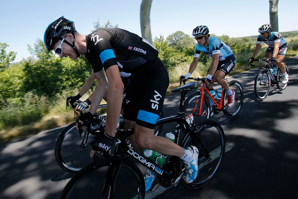 . Christopher Froome of Britain, left, and Sylvain Chavanel of France, second right,  ride in the pack during the seventh stage of the Tour de France cycling race over 205.5 kilometers (128.5 miles) with start in Montpellier and finish in Albi, southern France, Friday July 5, 2013. (AP Photo/Christophe Ena)