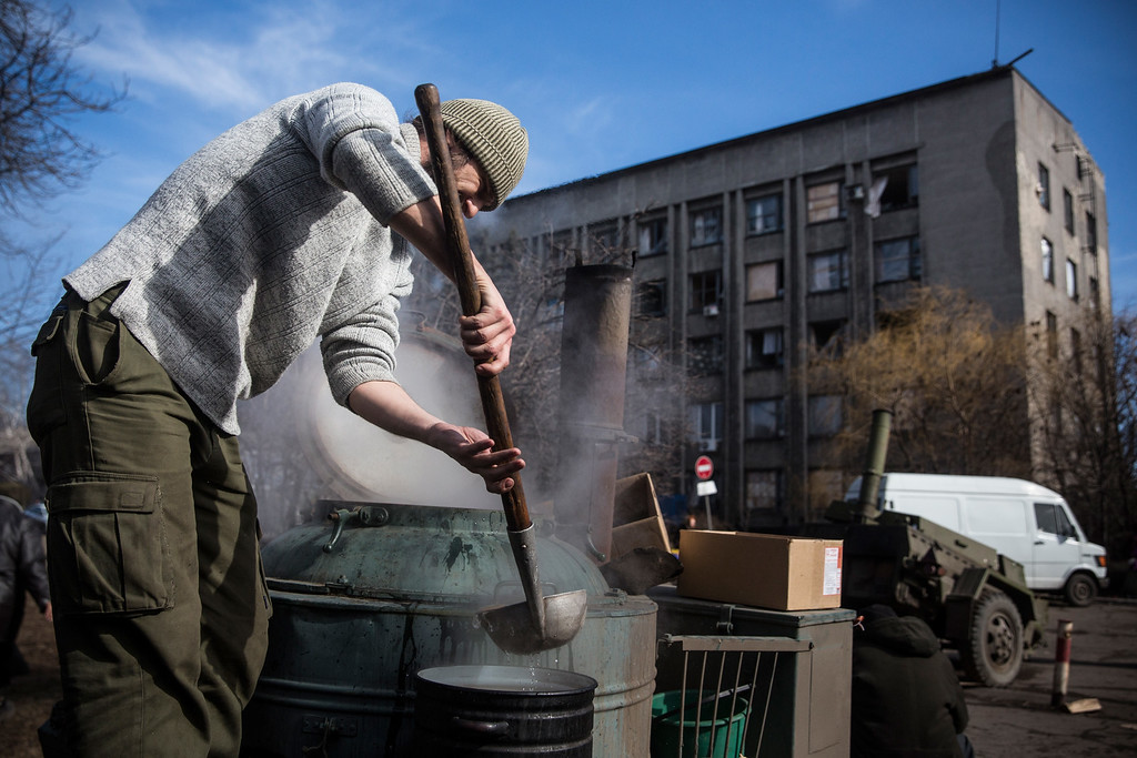 . DEBALTSEVE, UKRAINE - FEBRUARY 25:  Russian backed rebels prepare hot tea to be served to civilians on February 25, 2015 in Debaltseve, Ukraine. After approximately one month of fighting, Russian backed rebels successfully forced Ukrainian troops to withdraw from the town of 100,00 people on February 18. Only approximately 11,000 civilians remain in the town. Debaltseve is considered an asset to both Ukrainians and the rebels due to the railway station and it\'s connection to other eastern Ukranian towns.  (Photo by Andrew Burton/Getty Images)