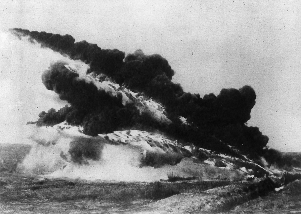 . 30th June 1917:  A flame thrower from WW I spits flame and black smoke into the air.  (Photo by Hulton Archive/Getty Images)