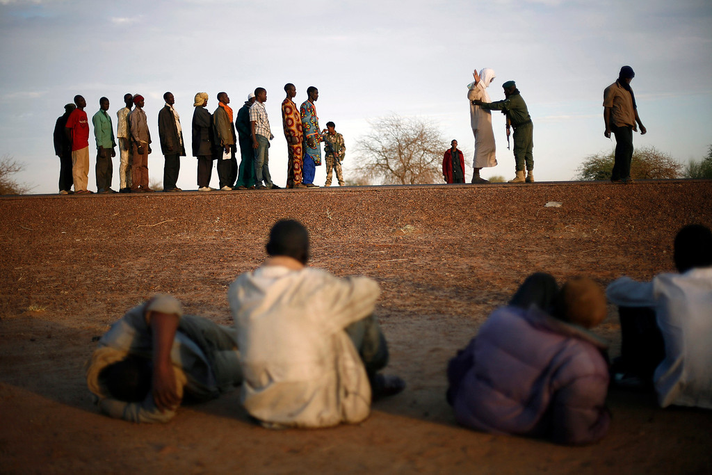 . This Feb. 12, 2013 file photo shows travelers driving from Niamey, Niger, lining up to be searched at the entrance of Gao, northern Mali. Al-Qaida\'s North African arm is trying something new to stay relevant: Twitter. Al-Qaida in the Islamic Maghreb, or AQIM, is trying to move the battleground elsewhere, seeking to tap into social grievances and champion mainstream causes such as unemployment, all in bid to reverse decline and win new followers, appealing to widespread concerns, such as the repression and a sense of injustice that galvanized the Arab Spring revolts. (AP Photo/Jerome Delay, File)
