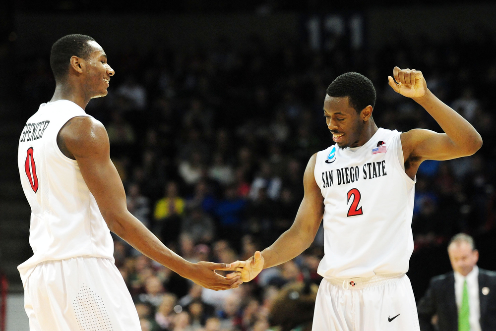 . Skylar Spencer #0 and Xavier Thames #2 of the San Diego State Aztecs celebrate their 63 to 44 win over the North Dakota State Bison during the Third Round of the 2014 NCAA Basketball Tournament at Spokane Veterans Memorial Arena on March 22, 2014 in Spokane, Washington.  (Photo by Steve Dykes/Getty Images)