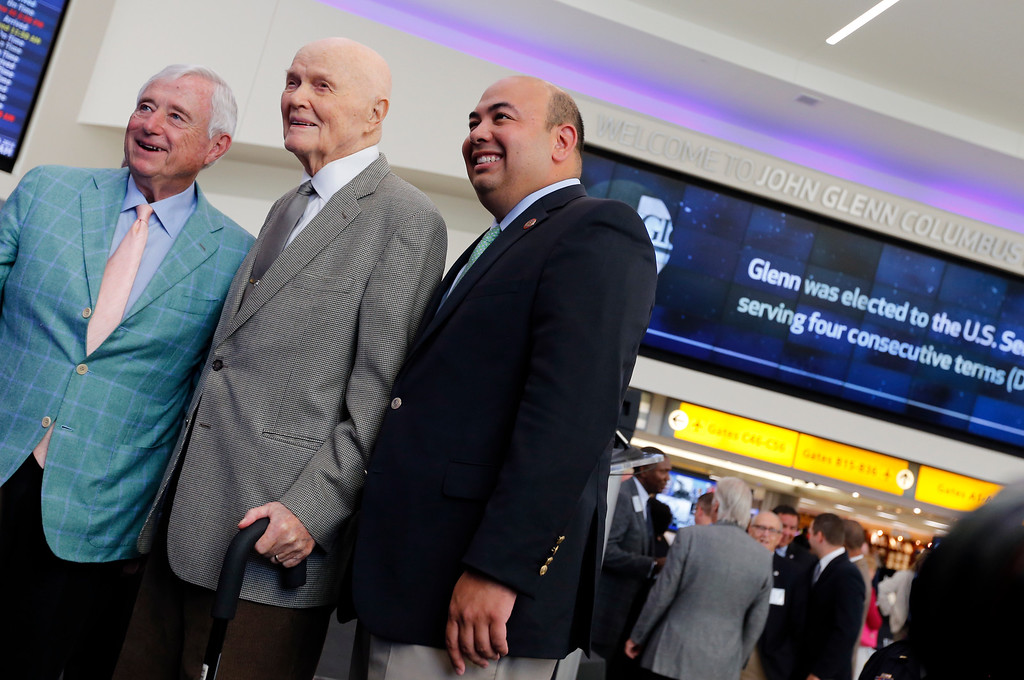 . Former U.S. Sen. John Glenn, center, poses for a photo with Jack Kessler, left, and Ohio House Speaker Cliff Rosenberger after a celebration for the renaming of Port Columbus International Airport to John Glenn Columbus International Airport Tuesday, June 28, 2016, in Columbus, Ohio. Senate Bill 159, which changes the name of the airport, goes into effect in September. (AP Photo/Jay LaPrete)