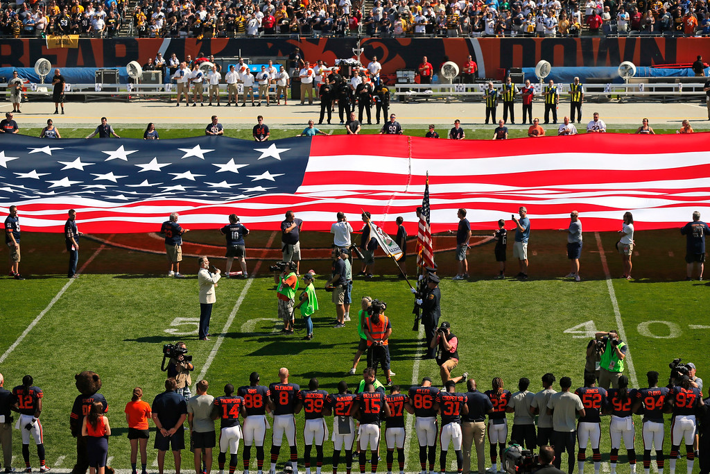 . The Pittsburgh Steelers side of the field is nearly empty during the playing of the national anthem before an NFL football game between the Steelers and Chicago Bears, Sunday, Sept. 24, 2017, in Chicago. The Pittsburgh Steelers players did not come out to the field during the anthem. (AP Photo/Kiichiro Sato)