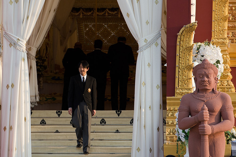 . Japanese Prince Akishino leaves the crematorium where a coffin bearing the remains of Cambodia\'s late King Norodom Sihanouk is placed before his cremation, near the Royal Palace in Phnom Penh on February 4, 2013. Thousands of mourners massed in the Cambodian capital as the kingdom cremated its revered former King Norodom Sihanouk, who steered his country through six turbulent decades. AFP PHOTO/ Nicolas  ASFOURI/AFP/Getty Images