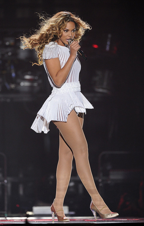 ". IMAGE DISTRIBUTED FOR PARKWOOD ENTERTAINMENT - Singer Beyonce performs on the opening night of her ""Mrs. Carter Show World Tour 2013\"", on Monday, April 15, 2013 at the Kombank Arena in Belgrade, Serbia. Beyonce is wearing a custom, hand beaded white peplum one-piece by designers Ralph & Russo. (Photo by Frank Micelotta/Invision for Parkwood Entertainment/AP Images)"