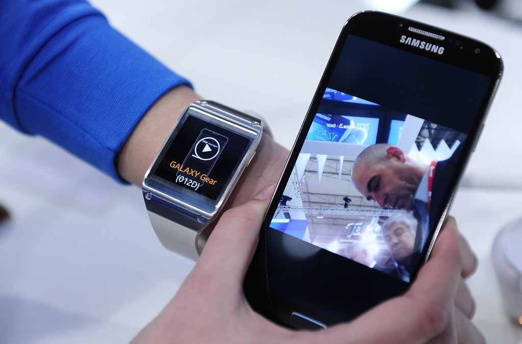 . The Samsung Gear smartwatch is presented at the Mobile World Congress in Barcelona, on February 24, 2014.  The Mobile World Congress runs from the 24 to 27 February where participants and visitors alike can attend conferences, network, discover cutting-edge products and technologies at among the 1,700 exhibitors as well as seek industry opportunities and make deals.   JOSEP LAGO/AFP/Getty Images