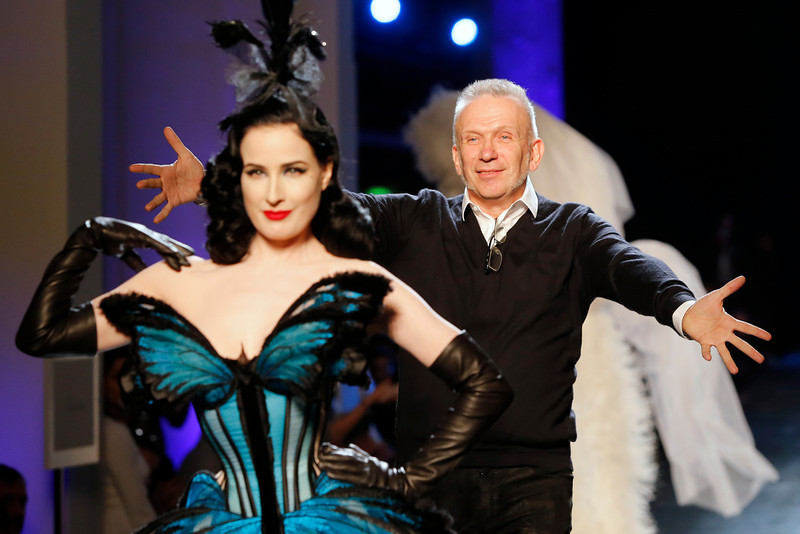 . French fashion designer Jean-Paul Gaultier, right, rushes towards burlesque artist Dita Von Teese at the end of his Spring-Summer 2014 Haute Couture fashion collection, presented Wednesday, Jan. 22, 2014 in Paris. (AP Photo/Jacques Brinon)