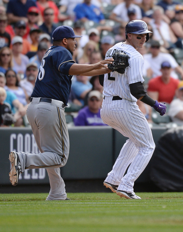 . DENVER, CO - JUNE 20: Milwaukee pitcher Wily Peralta tagged out Troy Tulowitzki in a rundown in the eighth inning. The Milwaukee Brewers defeated the Colorado Rockies 9-4 at Coors Field Saturday afternoon, June 21, 2014. Photo by Karl Gehring/The Denver Post