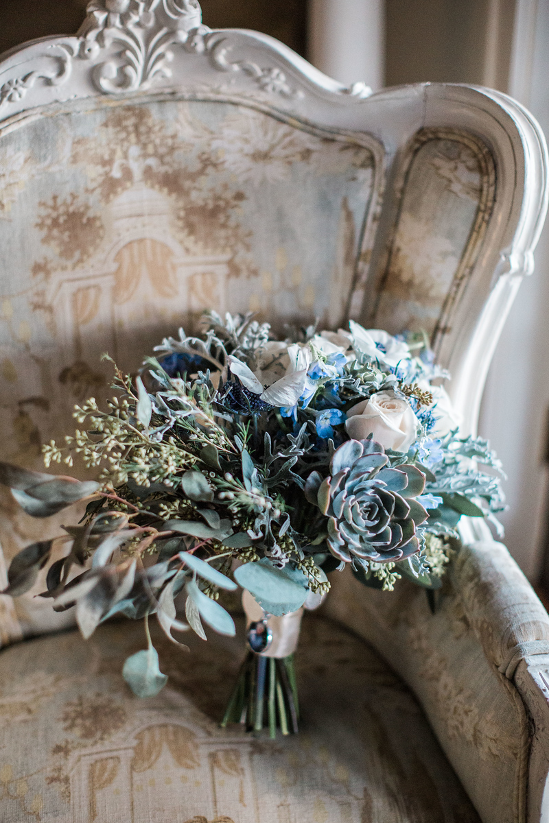 Bluemont Vineyards wedding photos wedding bouquet with greens and blues. The bridal bouquet included eucalyptus, lambs ear, succulents, and roses. Photos by the best Washington DC wedding photographer Jalapeno Photography.