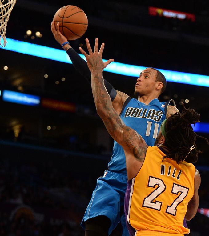 . Dallas Mavericks guard Monta Ellis (11) drives past Los Angeles Lakers forward Jordan Hill (27) in the second half during an NBA basketball game in Los Angeles, Calif., on Friday, April 4, 2014. Dallas Mavericks won 107-95.  (Keith Birmingham Pasadena Star-News)