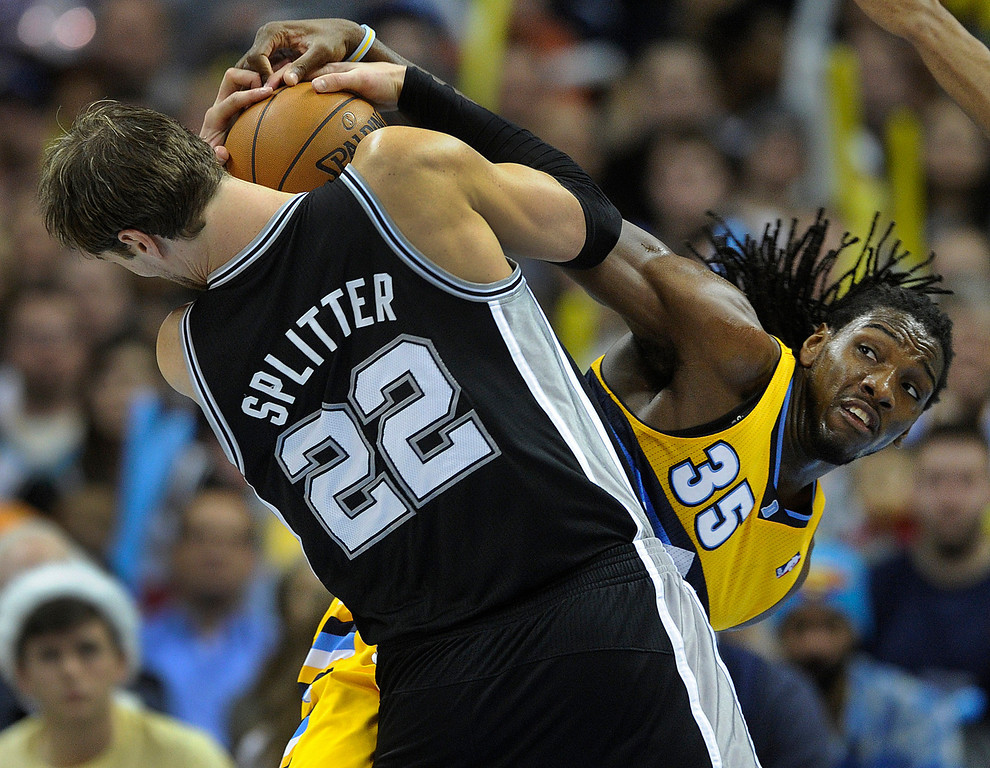 . Denver forward Kenneth Faried (35) tied up Spurts forward Tiago Splitter (22) in the second half. The Denver Nuggets defeated the San Antonio Spurs 112-106 at the Pepsi Center Tuesday night, December 18, 2012. Karl Gehring/The Denver Post