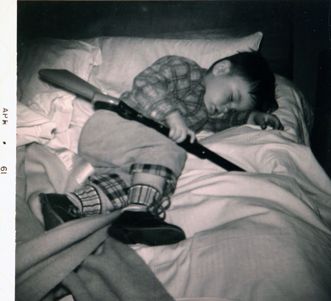 Normie sleeping with his gun.JPG
