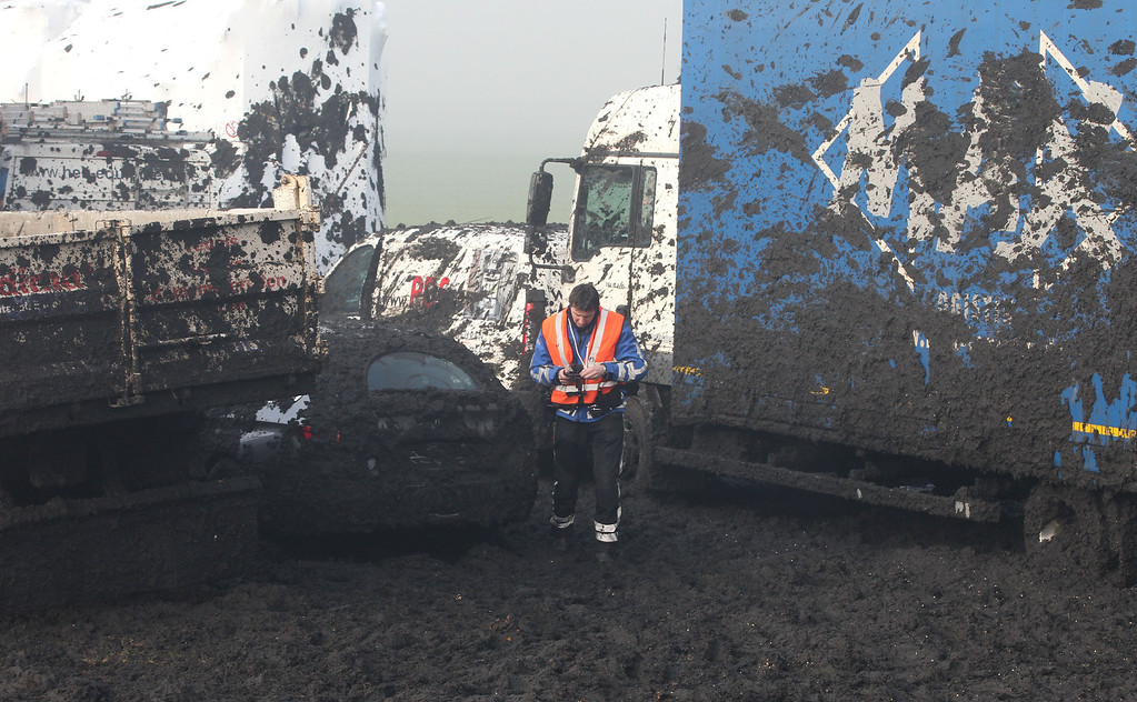 . Manure is spilled on the highway as about 132 vehicles crashed on the A19 highway in Zonnebeke, western Belgium, Tuesday, Dec.3, 2013.  (AP Photo/Yves Logghe)