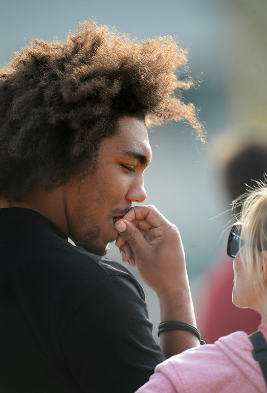 . USC DL Leonard Williams muches candy on the sidelines during practice, Tuesday, March 25, 2014, at USC. (Photo by Michael Owen Baker/L.A. Daily News)