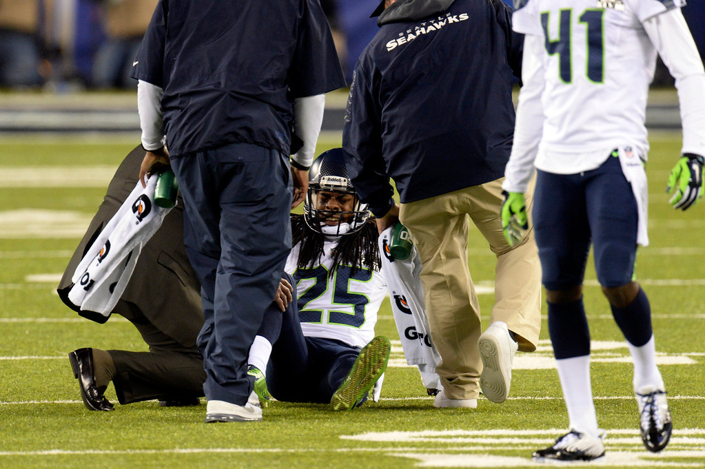 . Seattle Seahawks cornerback Richard Sherman (25) injured on the field during the third quarter.  The Denver Broncos vs the Seattle Seahawks in Super Bowl XLVIII at MetLife Stadium in East Rutherford, New Jersey Sunday, February 2, 2014. (Photo by Hyoung Chang//The Denver Post)