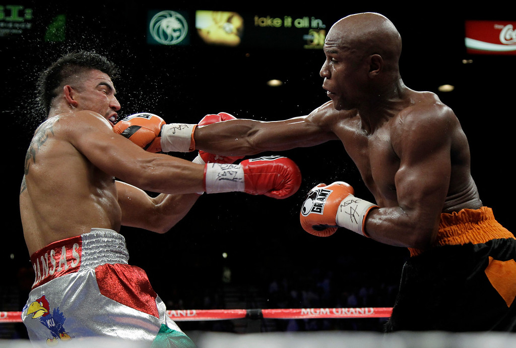 . Floyd Mayweather Jr. hits Victor Ortiz Floyd during their WBC welterweight title fight Saturday, Sept. 17, 2011, in Las Vegas. (AP Photo/Julie Jacobson)