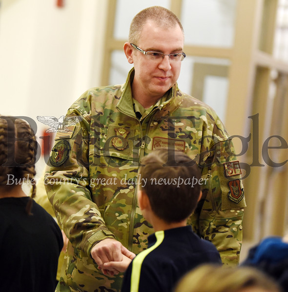 Harold Aughton/Butler Eagle: TSgt Randy Levander of the 911th Security Forces greets Butler Middle School students Friday, Nov. 22, 2019.