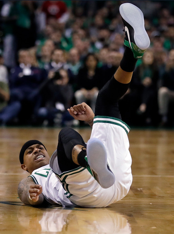 . Boston Celtics guard Isaiah Thomas ends up on his back after a collision during the first quarter of Game 7 of a second-round NBA basketball playoff series against the Washington Wizards, Monday, May 15, 2017, in Boston. (AP Photo/Charles Krupa)