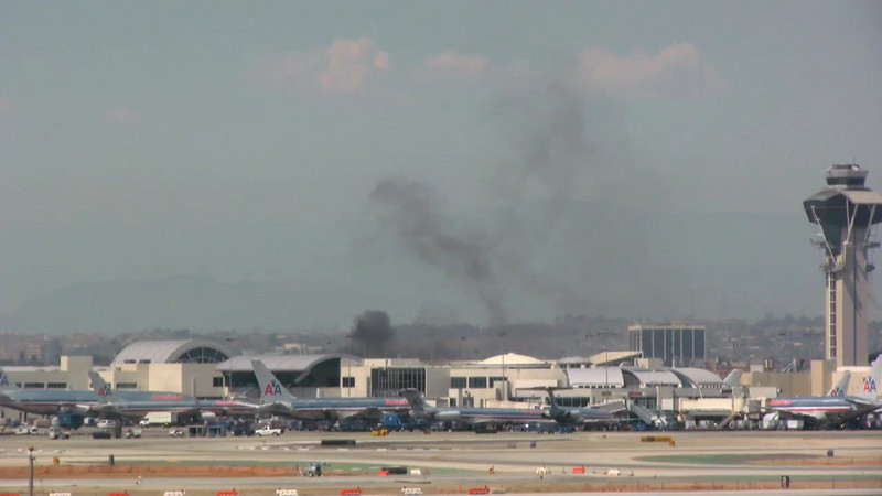 FIRE at LAX 05-18-08. Shot with a Canon HV30 video camera, edited in Final Cut Pro. This was a fire caused by some faulty wiring for an air conditioning unit at one of the terminals.