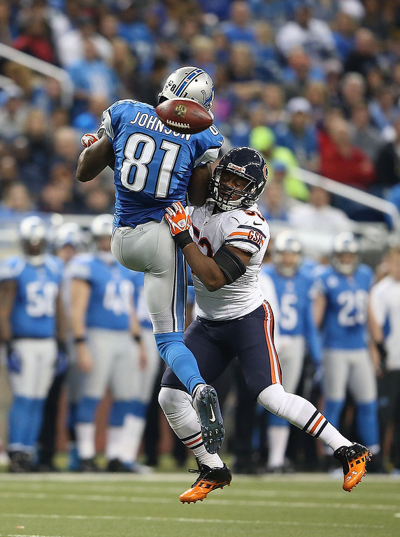 . Nick Roach #53 of the Chicago Bears breaks up the pass intended for Calvin Johnson #81 of the Detroit Lions during the game at Ford Field on December 30, 2012 in Detroit, Michigan. The Bears defeted the Lions 26-24.  (Photo by Leon Halip/Getty Images)