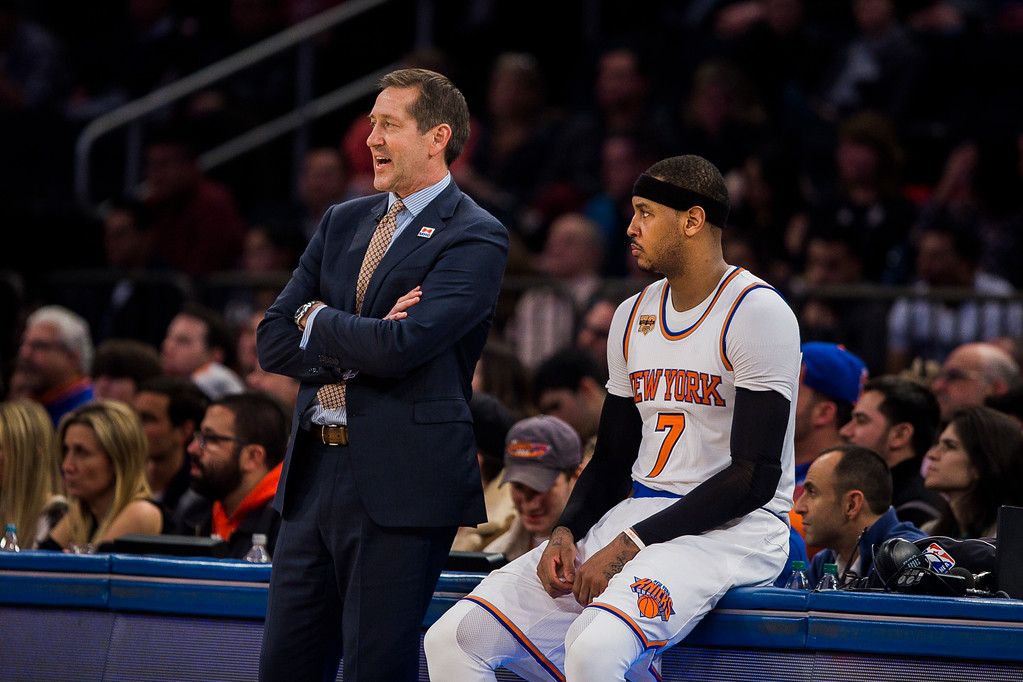 . New York Knicks coach Jeff Hornacek, left, talks to Carmelo Anthony during the second half of the team\'s NBA basketball game against the Cleveland Cavaliers on Saturday, Feb. 4, 2017, in New York. (AP Photo/Andres Kudacki)