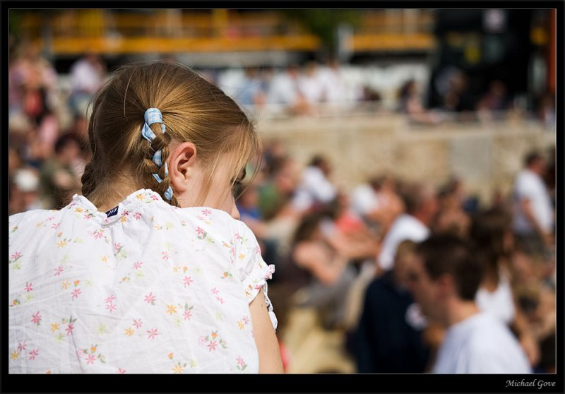 Young girl fascinated by the performers on stage (83019137).jpg