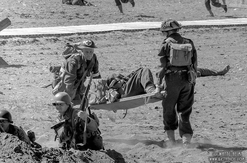 Carrying the Wounded   Black & White Photography by Wayne HEim