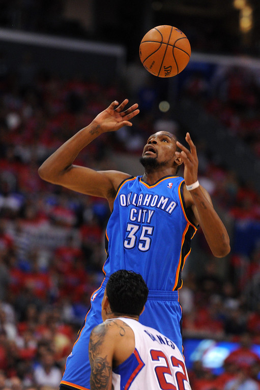 . The Thunder\'s Kevin Durant loses the ball while being defended by the Clippers\' Matt Barne, Thursday, May 15, 2014, at Staples Center. (Photo by Michael Owen Baker/Los Angeles Daily News)