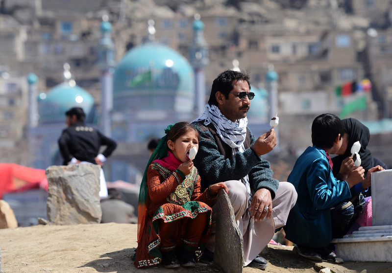 . An Afghan family sit and eat ice-cream near the Sakhi shrine, the centre of the Afghanistan new year celebrations in Kabul during Nowruz festivities on March 21, 2013. Nowruz, one of the biggest festivals of the war-scarred nation, marks the first day of spring and the beginning of the year in the Persian calendar. Nowruz is calculated according to a solar calendar, this coming year marking 1392. MASSOUD HOSSAINI/AFP/Getty Images