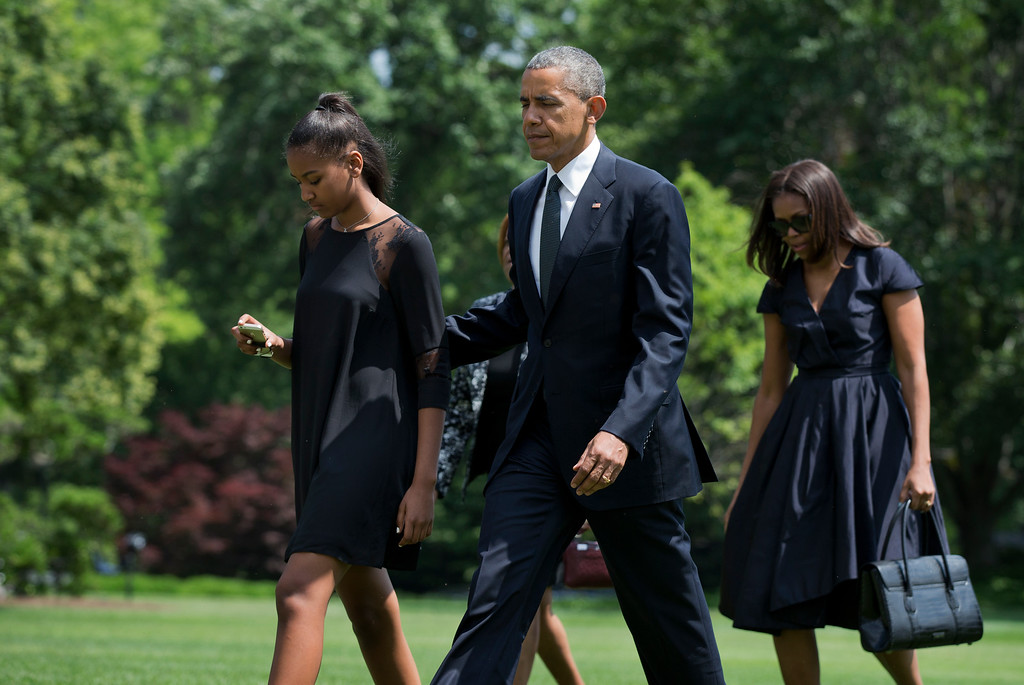 . President Barack Obama with his family,  daughter Sasha Obama, left, mother-in-law Marian Robinson and first lady Michelle Obama, right, arrive the White House in Washington, Saturday, June 6, 2015. President Obama, accompanied by his family, joined Vice President Joe Biden in bidding farewell Saturday to his eldest son, Beau Biden. The former Delaware attorney general died last Saturday of brain cancer. He was 46. (AP Photo/Manuel Balce Ceneta)