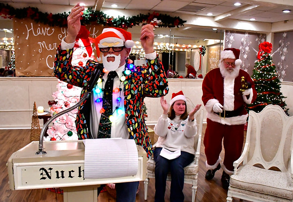 12/18/2018 Mike Orazzi | Staff Dave Pasqualicchio leads The Annual Forestville Carol Sing inside Nuchie's Restaurant on Tuesday night.