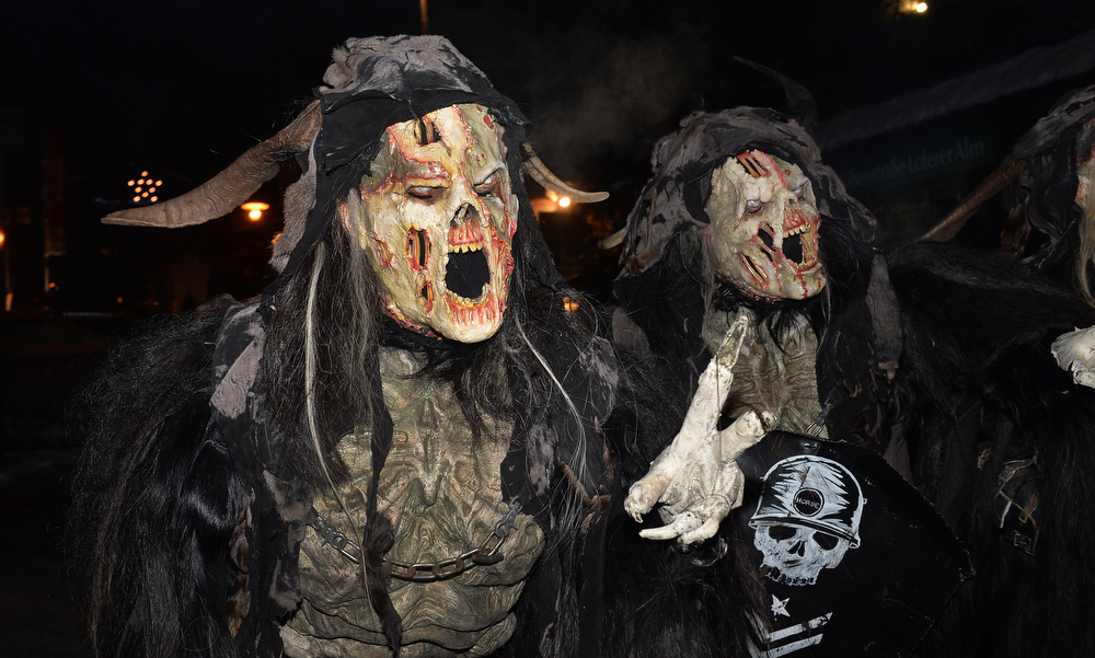 . Men dressed as a Krampus, the companion of St. Nicholas and one of Austria\'s unique Advent traditions, makes their way during a traditional Krampus procession in Lofer, Austrian province of Salzburg, Saturday, Nov. 30, 2013. (AP Photo/Kerstin Joensson)