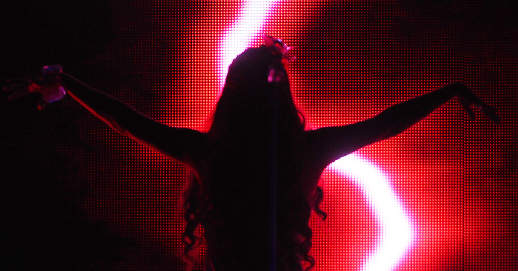 . Classical Soprano Sarah Brightman is silhouetted against the screen at the opening of the song Beautiful Day during her performance Thursday, Oct. 17, 2013, at the Xcel Energy Center in Saint Paul. (Pioneer Press: John Autey)