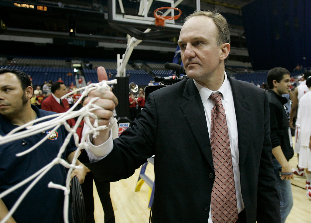 . Ohio State coach Thad Matta holds the net following a 92-76 win over Memphis in the  NCAA South Regional final basketball game at the Alamodome in San Antonio Saturday, March 24, 2007.  (AP Photo)