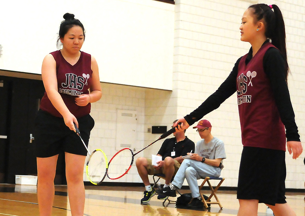 . Johnson High School seniors Coua Lee, left, and Jenny Vang, tap rackets after scoring a point against Harding\'s Anna Vue and Yer Lor in doubles at the team portion of the Minnesota State Badminton Tournament. (Pioneer Press: John Autey)