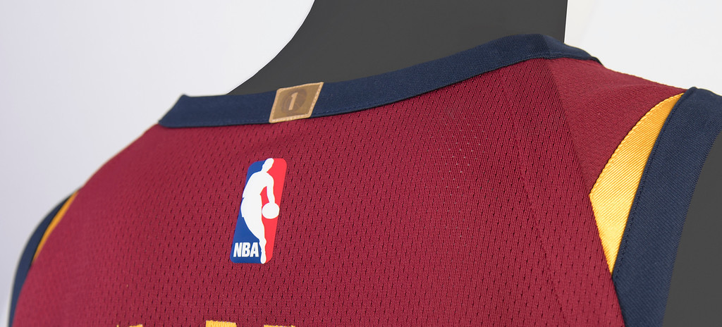 . A small square gold patch on the back center collar of each jersey displays the number �1� positioned inside an outline of the Larry O�Brien trophy to represent the franchise�s first NBA championship in 2016. This is a standard feature on the uniforms of all teams that have won an NBA championship.   (Courtesy Cleveland Cavaliers)