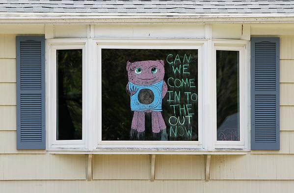 Sign in Tewksbury house window 051220
