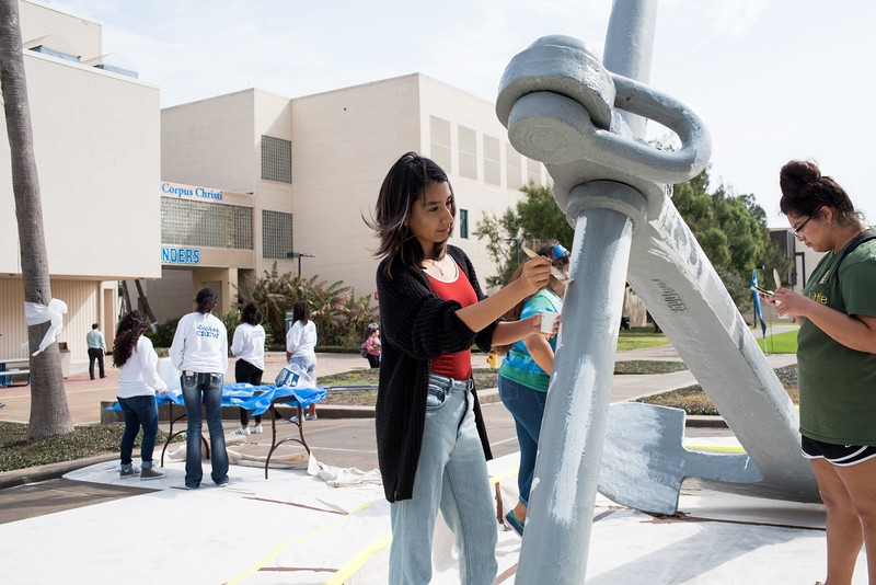 Paola Lopez takes part in painting the anchor in front of the University Center, during the Homecoming tradition called Anchors Aweigh.   Click on the link for more information on upcoming Homecoming events: http://bit.ly/18fYq5V