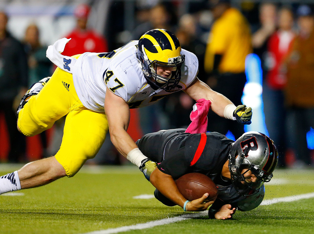 . Rutgers quarterback Gary Nova (10) is sacked by Michigan\'s Jake Ryan (47) during the second half of an NCAA college football game Saturday, Oct. 4, 2014, in Piscataway, N.J. Rutgers defeated Michigan 26-24. (AP Photo/Rich Schultz)