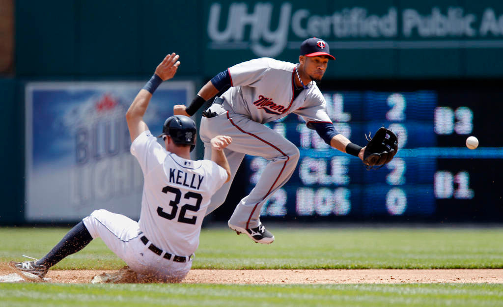 . Shortstop Pedro Florimon of the Minnesota Twins is pulled off the bag to field the ball as Don Kelly  of the Detroit Tigers steals second base at Comerica Park. (Photo by Duane Burleson/Getty Images)
