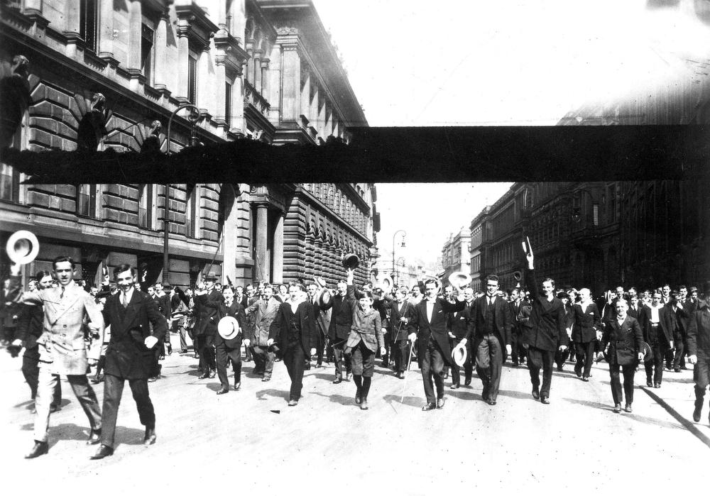 Description of . German volunteers march on a German street to join the army for the Great War, Aug. 1914. (AP Photo)