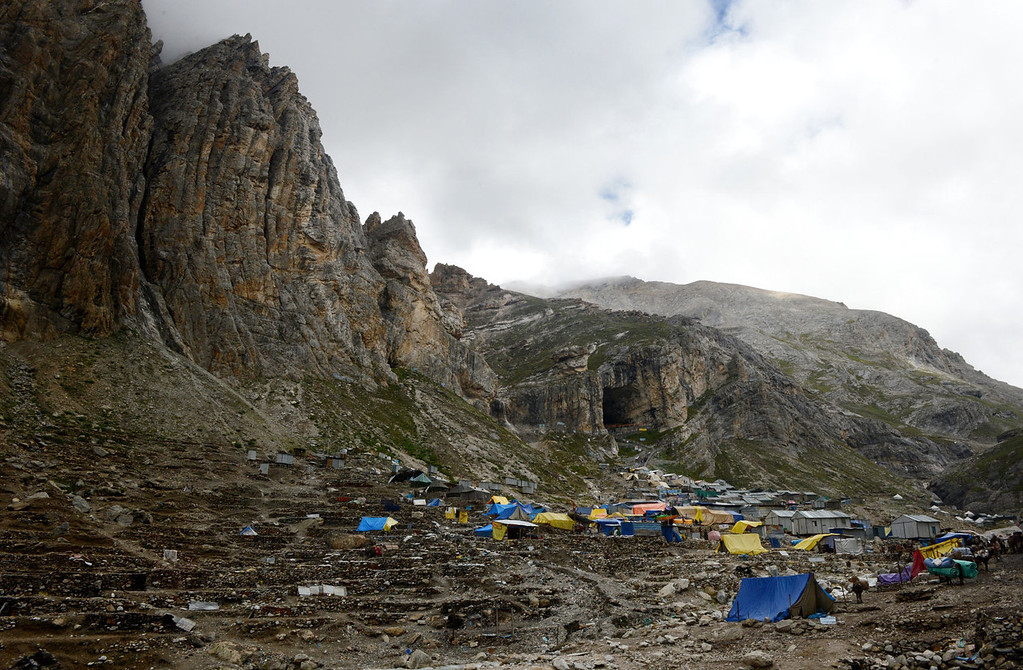 . A view of the Amarnath Cave on August 18, 2013. Every year, hundreds of thousands of pilgrims trek through treacherous mountains in revolt-torn Kashmir, along icy streams, glacier-fed lakes and frozen passes, to reach the Amarnath cave, located at an altitude of 3,857 meters (12,729 feet), where a Shiva Lingam, an ice stalagmite shaped as a phallus and symbolizing the Hindu God Shiva, stands for worship.   TAUSEEF MUSTAFA/AFP/Getty Images