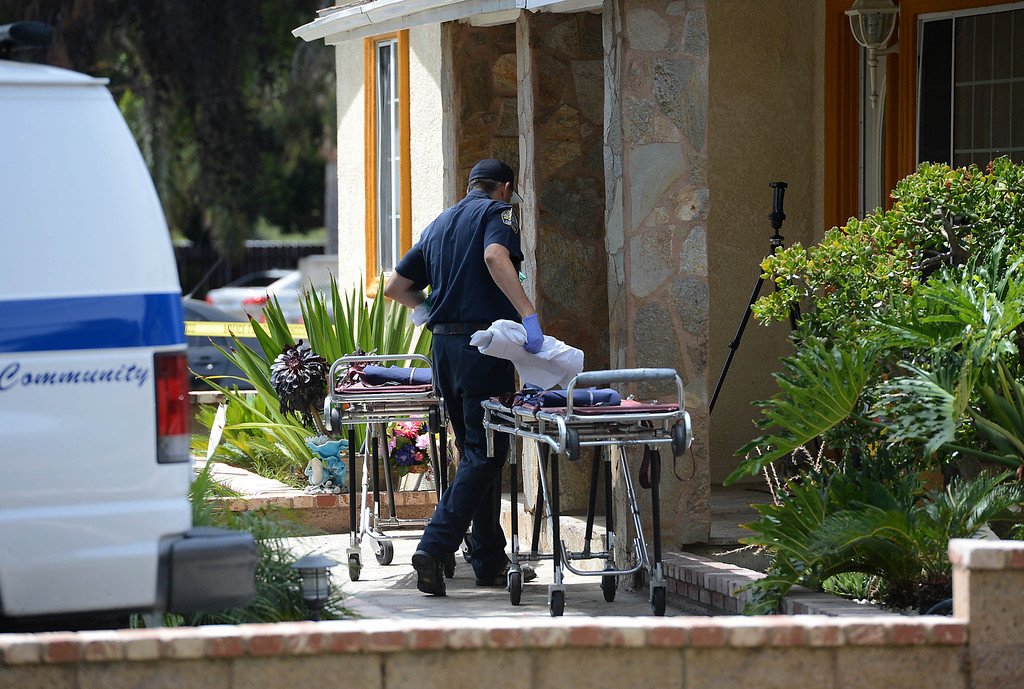 . Pomona Police investigate the scene of a murder-suicide in the 2100 block of north Ramsey Way in Pomona, CA, Friday, May 9, 2014. (Jennifer Cappuccio Maher/Inland Valley Daily Bulletin)
