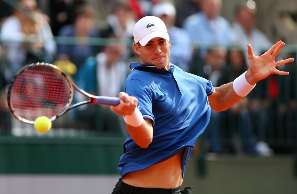 . John Isner of the United States of America plays a forehand during the Men\'s Single match against Carlos Berlocq during day two of the French Open at Roland Garros on May 27, 2013 in Paris, France.  (Photo by Getty Images/Getty Images)