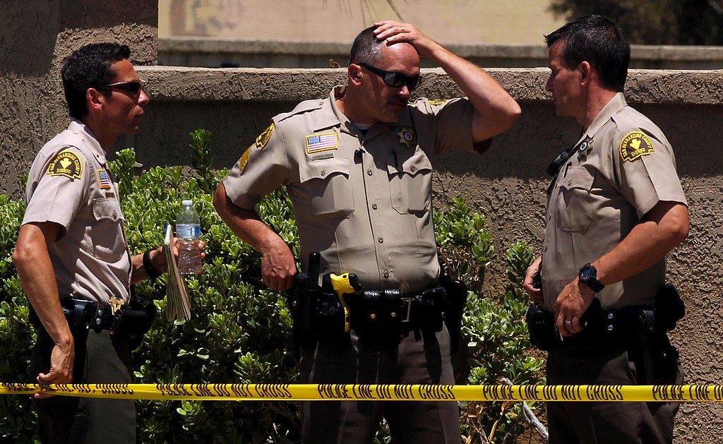 """. A San Bernardino County Sheriff\'s deputy is in the hospital after being \""""brazenly ambushed\"""" and shot Tuesday morning on East Date Street near Del Rosa Avenue, authorities say. Rick Sforza staff photo The Sun. (Staff photo by Rick Sforza)"""
