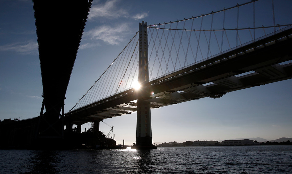 . The new eastern span of the Bay Bridge rises up on the north side of the 1936 cantilever section over San Francisco Bay on Friday, Aug. 23, 2013. (Karl Mondon/Bay Area News Group)