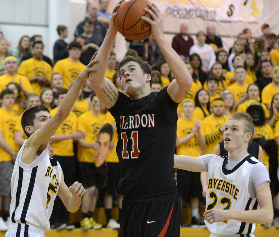 . Duncan Scott/DScott@News-Herald.com Chardon\'s Joe Fodor goes up for a shot in the second quarter defended by Riverside\'s Brad Rinella, left, and Austin Hess. Riverside won Friday\'s PAC matchup 49-43 at the Riverside Community Field House.