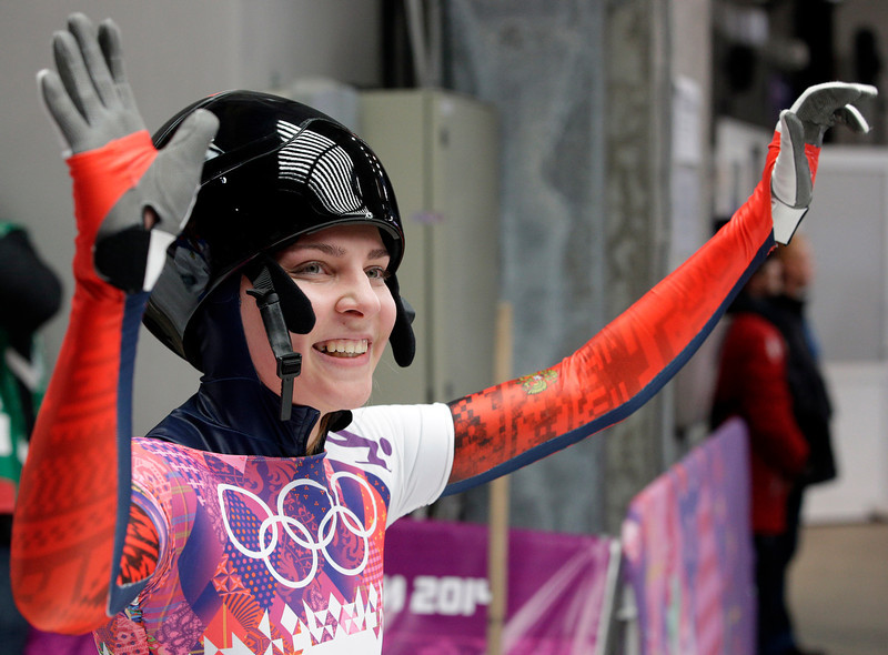 . Elena Nikitina of Russia waves to supporters after her third run during the women\'s skeleton competition at the 2014 Winter Olympics, Friday, Feb. 14, 2014, in Krasnaya Polyana, Russia. (AP Photo/Michael Sohn)