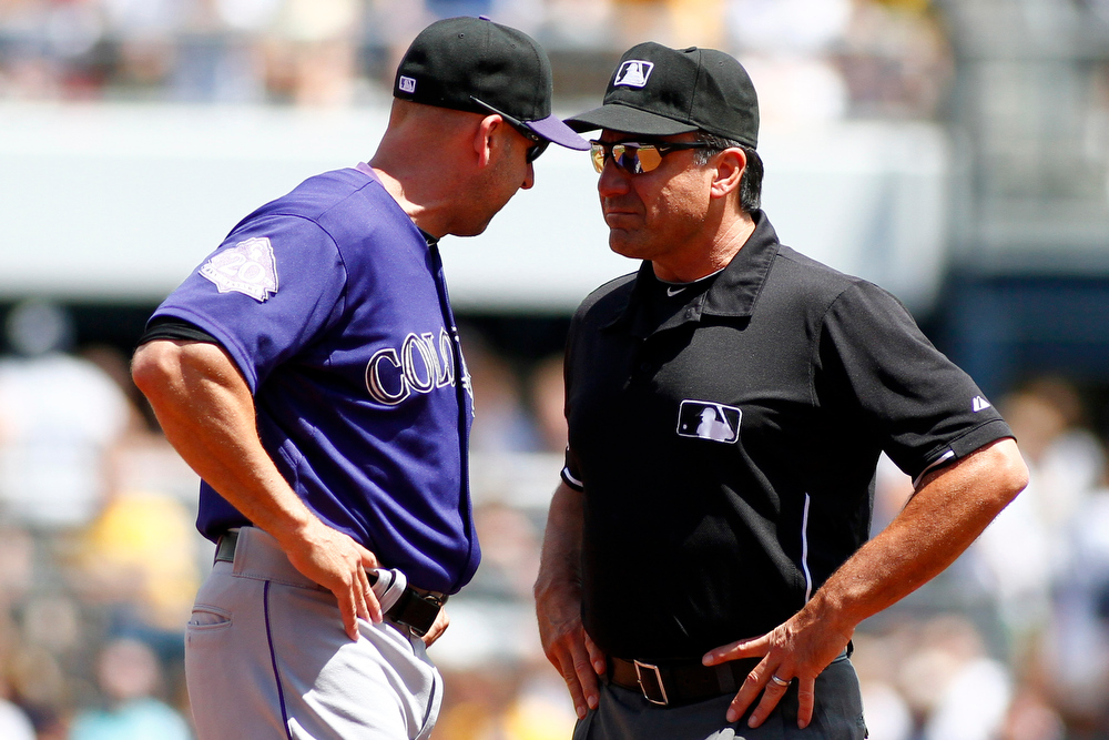 . Manger Walt Weiss #22 of the Colorado Rockies aregues with second base umpire Phil Cuzzi in the third inning during the game on August 4, 2013 at PNC Park in Pittsburgh, Pennsylvania.  (Photo by Justin K. Aller/Getty Images)